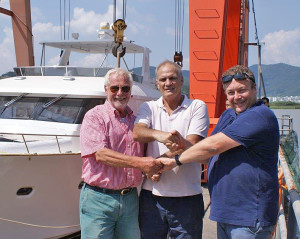 Owner, builder and Explorer's North Europe Dealer shake hands after a successful sea trial.